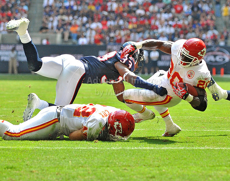 17 Oct 2010:  <br /> Kansas City Chiefs running back Thomas Jones #20 carries the ball inside the 10 yard line and is tackled by Houston Texans safety Troy Nolan #33 in a game between the Kansas City Chiefs and the Houston Texans at Reliant Stadium in Houston, Texas.<br /> Houston wins 35-31