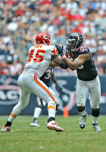 Oct 17 2010:  <br /> Houston Texans defensive end Mario Williams #90 fights off Kansas City Chiefs tight end Leonard Pope #45<br /> in a game between Kansas City Chiefs and the Houston Texans at Reliant Stadium in Houston, Texas.<br /> Houston wins 35-31<br /> (Credit Image: © Manny Flores/Cal Sport Media)