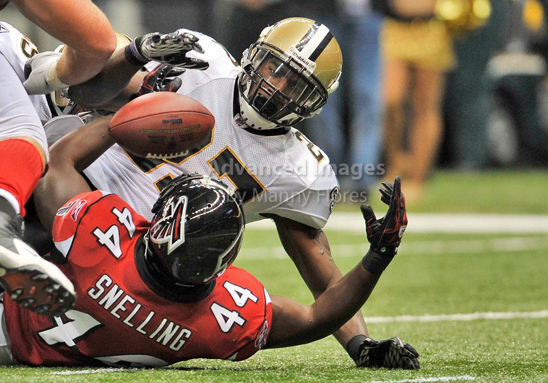 Sept 26 2010:  <br /> Atlanta Falcons running back Jason Snelling #44 fumbles the ball as New Orleans Saints cornerback Malcolm Jenkins #27 hits him in a game between Atlanta Falcons vs New Orleans Saints at the Superdome in New Orleans, LA. <br /> Atlanta Falcons win in overtime 27-24<br /> (Credit Image: © Manny Flores/Cal Sport Media)
