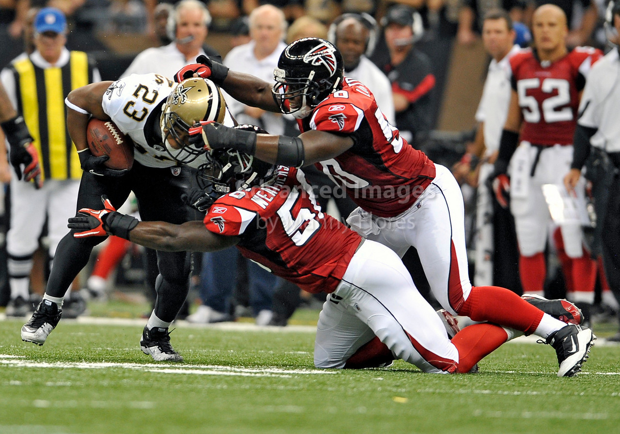 Sept 26 2010:  <br /> New Orleans Saints running back Pierre Thomas #23 tackled by Atlanta Falcons linebacker Sean Weatherspoon #56<br /> in a game between Atlanta Falcons vs New Orleans Saints at the Superdome in New Orleans, LA. <br /> Atlanta Falcons win in overtime 27-24<br /> (Credit Image: © Manny Flores/Cal Sport Media)