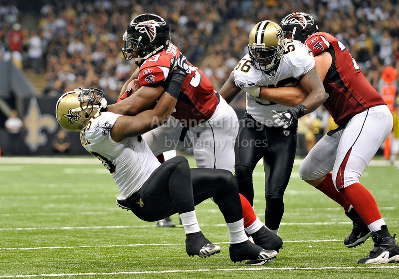 Sept 26 2010:  <br /> Atlanta Falcons running back Michael Turner #33 is stopped short of the goal line by New Orleans Saints linebacker Marvin Mitchell #50<br /> in a game between Atlanta Falcons vs New Orleans Saints at the Superdome in New Orleans, LA. <br /> Atlanta Falcons win in overtime 27-24<br /> (Credit Image: © Manny Flores/Cal Sport Media)