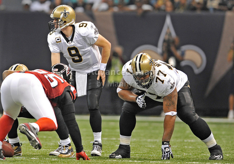 Sept 26 2010:  <br /> New Orleans Saints quarterback Drew Brees #9 and New Orleans Saints guard Carl Nicks #77 get ready for action<br /> in a game between Atlanta Falcons vs New Orleans Saints at the Superdome in New Orleans, LA. <br /> Atlanta Falcons win in overtime 27-24<br /> (Credit Image: © Manny Flores/Cal Sport Media)