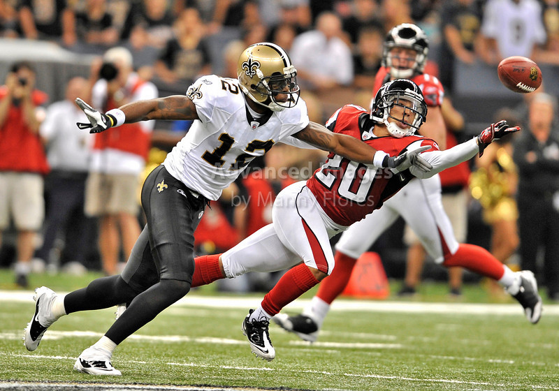 Sept 26 2010:  <br /> New Orleans Saints wide receiver Marques Colston #12 and Atlanta Falcons cornerback Brent Grimes #20 fight for the ball<br /> in a game between Atlanta Falcons vs New Orleans Saints at the Superdome in New Orleans, LA. <br /> Atlanta Falcons win in overtime 27-24<br /> (Credit Image: © Manny Flores/Cal Sport Media)