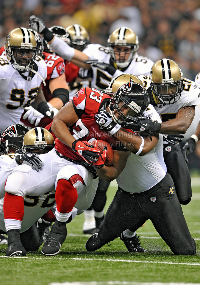 Sept 26 2010:  <br /> Atlanta Falcons running back Michael Turner #33 is tackled by several Saints players in a game between Atlanta Falcons vs New Orleans Saints at the Superdome in New Orleans, LA. <br /> Atlanta Falcons win in overtime 27-24<br /> (Credit Image: © Manny Flores/Cal Sport Media)