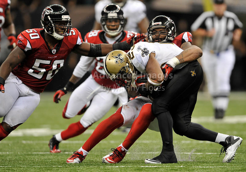Sept 26 2010:  <br /> New Orleans Saints running back Pierre Thomas #23 is tackled by New Orleans Saints linebacker Jo-Lonn Dunbar #56<br /> in a game between Atlanta Falcons vs New Orleans Saints at the Superdome in New Orleans, LA. <br /> Atlanta Falcons win in overtime 27-24<br /> (Credit Image: © Manny Flores/Cal Sport Media)