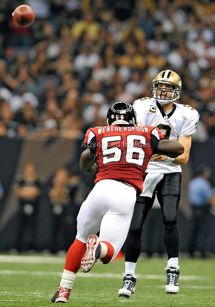 Sept 26 2010:  <br /> New Orleans Saints quarterback Drew Brees #9 passes the ball as Atlanta Falcons linebacker Sean Weatherspoon #56 closes in<br /> in a game between Atlanta Falcons vs New Orleans Saints at the Superdome in New Orleans, LA. <br /> Atlanta Falcons win in overtime 27-24<br /> (Credit Image: © Manny Flores/Cal Sport Media)
