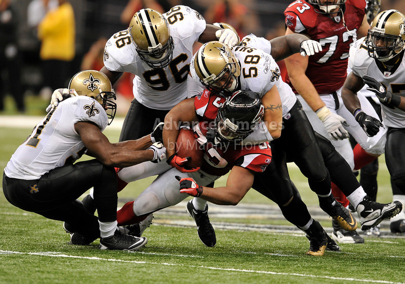Sept 26 2010:  <br /> Atlanta Falcons running back Michael Turner #33 is tackled by New Orleans Saints linebacker Scott Shanle #58<br /> in a game between Atlanta Falcons vs New Orleans Saints at the Superdome in New Orleans, LA. <br /> Atlanta Falcons win in overtime 27-24<br /> (Credit Image: © Manny Flores/Cal Sport Media)
