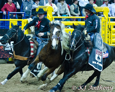 The 54th Wrangler National Finals Rodeo at Thomas and Mack in Las Vegas, NV - December 6 to 15, 2012.  Pickup Men of the NFR work to ensure the safety of both the contestants and the stock.