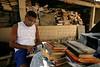 """Elio Caldas, browses books at the Tobias Barreto Community Library in Rio de Janeiro, Brazil. Founded in 1998 in his own home by day laborer Evando dos Santos, the library has some 40,000 volumes and will soon move into a new building nearby designed by Brazilian Architect Oscar Niemeyer. (Australfoto/Douglas Engle)<br /> <br /> Elio Caldas,mira a libros en la biblioteca comunitaria """"Tobias Barreto"""" en Rio de Janeiro, Brazil. Fundada en 1998 en su propria casa por el obrero Evando dos Santos, la biblioteca contiene alrededor de 40 mil volumenes y mudaria para un edificio disenado por el arquitecto Brasileno Oscar Niemeyer. (Australfoto/Douglas Engle)"""