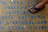 """Evando dos Santos stands on the sidewalk outside at the Tobias Barreto Community Library in Rio de Janeiro, Brazil. Founded in 1998 in his own home by day laborer Evando dos Santo, the library has some 40,000 volumes and will soon move into a new building nearby designed by Brazilian Architect Oscar Niemeyer. (Australfoto/Douglas Engle)<br /> <br /> Envando dos Santos pisa en la calzada fuera de la biblioteca comunitaria """"Tobias Barreto"""" en Rio de Janeiro, Brazil. Fundada en 1998 en su propria casa por el obrero Evando dos Santos, la biblioteca contiene alrededor de 40 mil volumenes y mudaria para un edificio disenado por el arquitecto Brasileno Oscar Niemeyer. (Australfoto/Douglas Engle)"""