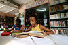 Gabriele Sthefanine Silva Azevedo, 13, studies at the community library in the Jardin Catarina neighborhood of Sao Goncalo, a poor city in the metropolitan Rio de Janeiro area, Sept. 19, 2005. Hoping to give neighborhood children a better education than they received, Carlos Luiz Leite and his wife Maria de Penha de Oliveira Mello started the library in their home in 2003 with about 100 books using their own money and labor. It has grown to over 5000 titles and their tiny home is filling with books as donations arrive, including brand new items from book publishers. Adults also use the resources to study, many who quit school early to work. (Australfoto/Douglas Engle)