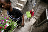 Slum resident Leonardo Souza Silva, left, and Temple student Joe Lulis carry seedlings through the narrow alleys of the Santa Marta slum in Rio de Janeirio, August 19, 2005. Using hydroponics, a little hard labor and lots of ingenuity, the Temple University students spend their vacation time building and installing a farming apparatus that turns the walls and roofs of slum residents into small gardens. The technology, part of a broader environmental movement known as green roofing, helps residents compensate for land shortages by supporting miniature plant nurseries from their homes. Green roofing is popular in Europe for its environmental and aesthetic benefits, but this is an initial attempt to show that the technology can also provide sustenance for the poor. (Australfoto/Douglas Engle)(Australfoto/Douglas Engle)(Australfoto/Douglas Engle)