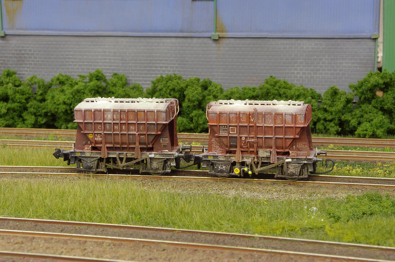 Graham Farish 22t Presflo's - these had either the boards or the factory applied weathering removed, before re-lettering and weathering. Wire coupling hooks have been added to one end of each wagon to address issues with the coupling distances.