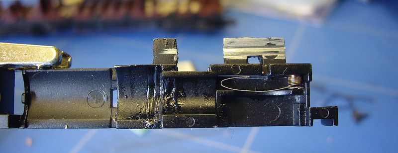 Another issue with this model was an inconsistent ride height at the powered bogie - this was found to be due to lack of spring tension at the powered bogie which was rectified by the addition of coupling springs to the inner current collection points.