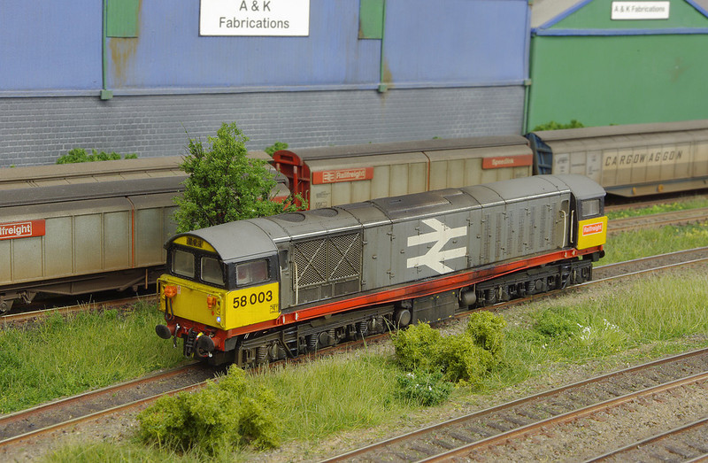 This Class 58 from Dapol has had little in the way of modifcation - the handrails have been modified all round, and some livery corrections have been made, before re-numbering and weathering.