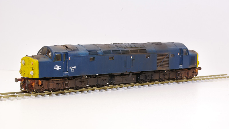 """A heavily modified Graham Farish Class 40 finished as 40056 in 1984 condition. Improvements include  a see-through etched roof grille with visible fan, replacement etchings for the cab window surrounds and windscreen wipers, further detailing of the fronts including handrails, headcode disk clips, lamp irons, and scratch built correctly sized and patterned headcode disks. The buffer-beams have been completely rebuilt to a higher profile in order to close the gap slightly and  re-position the buffers to the correct height. The dome shaped pony axle linkage covers have also been moved to the correct more central position, and the coupling entry hole has been covered with the correct rectangular slot cut into the buffer-beam.<br /> Not to mention a complete re-spray into BR Blue livery and serious weathering job!<br /> <a href=""""https://tonybuckton.smugmug.com/Trains/Class-40s/i-vnqdrW8"""">https://tonybuckton.smugmug.com/Trains/Class-40s/i-vnqdrW8</a>"""