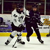Allen Park's Anthony Curcuru (13) looks to skate past Woodhaven's Nick Owczarzak during the host Jaguars' 8-1 victory on Saturday night in the 2016 Jaguar Thanksgiving Classic championship game. (MI Prep Zone photo gallery by RYAN DICKEY)