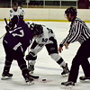 Warriors forward Dylan Gajewski (17) and Jaguars forward Joey Cullinan (21) faceoff. Gajewski scored the lone goal for Woodhaven. Allen Park defeated Woodhaven 8-1 to capture the 2016 Jaguar Thanksgiving Classic at Allen Park Civic Arena on Saturday night. (MI Prep Zone photo gallery by RYAN DICKEY)