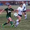 Allen Park's Ashley Armstrong (9) controls the ball and prepares to get by Taylor Truman's Lilly Sanchez (10). Armstrong scored the game's only goal. The Jags blanked the host Cougars 1-0 on Wednesday to stay undefeated early in the season. (MI Prep Zone photo gallery by RYAN DICKEY)