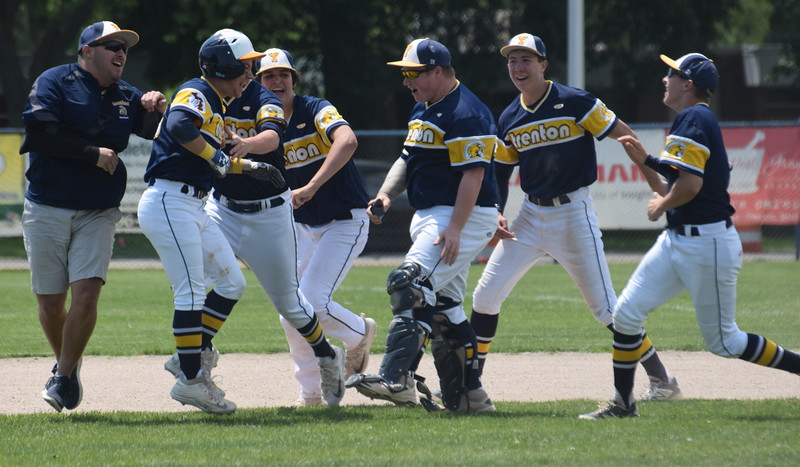 Trenton celebrates after a 6-5 comeback victory against  Riverview on Saturday in the Division 2, District 56 semifinals. The Pirates went on to beat  Grosse Ile 13-3 in five innings to claim the title. (MIPrepZone Photo Gallery by Frank Wladyslawski)
