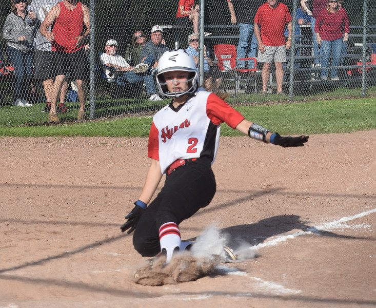 New Boston Huron's Chelsea Hamilton slides in with the game-winning run in the bottom of the seventh inning on Wednesday against visiting Flat Rock. It was the only run of the game, as the Chiefs came away with a 1-0 victory. (MIPrepZone Photo Gallery by Frank Wladyslawski)