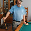Jon Siegel enjoys a little recreational break -- naturally he made the pool cue himself!