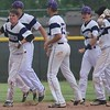 Woodhaven celebrates its 3-2 comeback win over Downriver League rival Gibraltar Carlson in the district opener on Tuesday at Woodhaven High School. (MIPrepZone photo gallery by Ricky Lindsay)