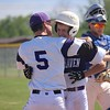Kyle Ray, left, celebrates with Jimmy Owczarzak, center, after Owczarzak scored in the first inning of Woodhaven's 3-2 comeback win over Downriver League rival Gibraltar Carlson in the district opener on Tuesday at Woodhaven. (MIPrepZone photo gallery by Ricky Lindsay)
