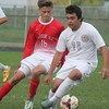 Luis Hernandez makes a move on Grosse Ile's Logan Watson. Grosse Ile scored a 5-0 win over host Riverview on Oct. 12, 2016. (MiPrepZone photo gallery by Terry Jacoby)