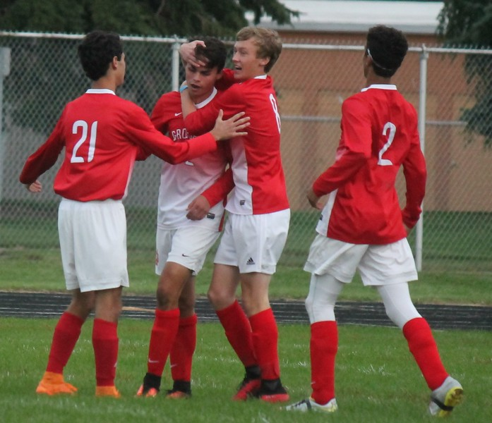The Red Devils celebrate David Cardinal's first goal.  Grosse Ile scored a 5-0 win over host Riverview on Oct. 12, 2016. (MiPrepZone photo gallery by Terry Jacoby)