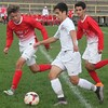 Riverview's Drew Chase draws some company as he heads up field. Grosse Ile scored a 5-0 win over host Riverview on Oct. 12, 2016. (MiPrepZone photo gallery by Terry Jacoby)
