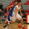 GI's Matthew Frost on the move. Grosse Ile defeated visiting Carlson 49-44 in overtime on Thursday, Dec. 22, 2016 in boys' basketball. (MiPrepZone Photo Gallery by Terry Jacoby)