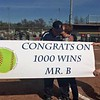 Longtime Trenton softball coach John Biedenbach was honored after he earned his 1,000th career victory on April 24 in a 3-2 win for the Trojans at Southgate Anderson. (Photo courtesy of Nikki Tanguay)
