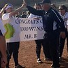 Longtime Trenton softball coach John Biedenbach celebrates with his players after his 1,000th career victory, which was a 3-2 win on April 24 at Southgate Anderson. (Photo courtesy of Nikki Tanguay)