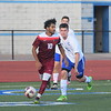 Melvindale's Mohamed Said (10) heads down the field on Wednesday night at Gibraltar Carlson. The senior netted all four goals in his team's 4-3 victory  against the Marauders. (MIPrepZone Photo Gallery by Frank Wladyslawski)
