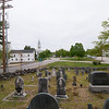 Hancock green view from the burial ground, with the last utility pole where the underground service begins, eliminating all of the poles and overhead lines through the green.