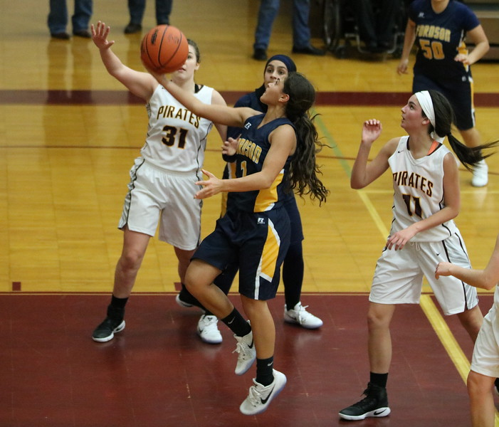 Rana Elhusseini (1) scores a layup. Her game-high 25 points led Dearborn Fordson to a 57-44 victory over host Riverview on Friday night. (Photo gallery for MIPrepZone by Jack VanAssche)