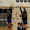 Riverview's Kelsey Ruffner (15) sends the ball over to the Gibraltar Carlson side during Wednesday's Class A, District 14 semifinals at Trenton. Ruffner and the Pirates swept the Marauders 3-0 and moved on to play in the championship game on Friday. (MIPrepZone Photo Gallery by Frank Wladyslawski)