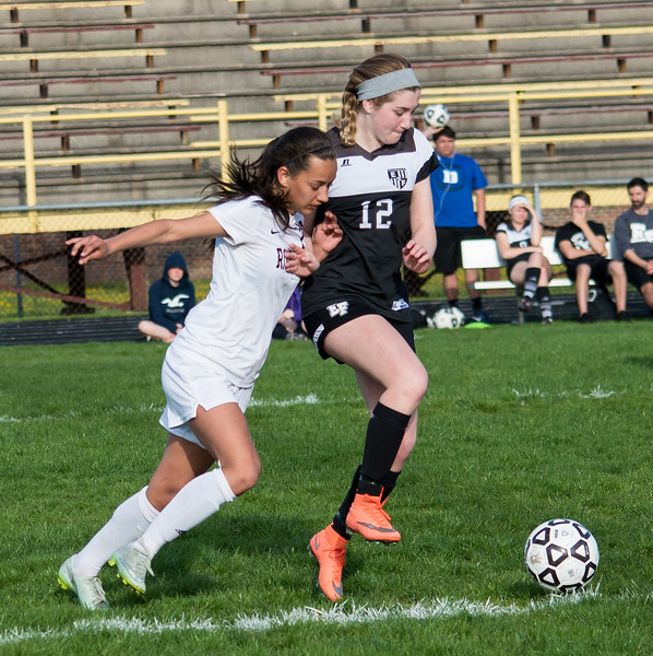 Lilly Woitowicz of Riverview and Maegan Beams of Edsel Ford battle for the ball in the non-league match played on Monday April 24, 2017 at Riverview Community High School. The Pirates defeated the Thunderbirds 5-1. (Photo gallery for MIPrepZone by Mimi Dorn)