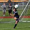Taylor Truman's Isabel Sanchez kicks the ball from deep in her own end on Wednesday night against Gibraltar Carlson in the district semifinals at Trenton. The Cougars went to an overtime shootout with the Marauders and ultimately lost the game by a score of 2-1.  (MIPrepZone Photo Gallery by Frank Wladyslawski)