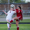 Grosse Ile's Sophie Tucker (3) and Riverview's Megan Scherer (6) battle for the ball Monday night on the Bucs home field. Sophie scored one of Grosse Ile's 4 goals in what was a 4-0 win for the visiting Red Devils. (MIPrepZone Photo Gallery by Mimi Dorn)