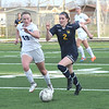Trenton headed to Woodhaven for a key Downriver League battle on Wednesday night and came away with a 3-1 victory. (MIPrepZone Photo Gallery by Frank Wladyslawski)