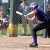 Woodhaven's Jessica Harrison bunts during Wednesday afternoon's game at Allen Park. The Warriors went on to suffer a 12-3 defeat against the first-place Jaguars. (MIPrepZone Photo Gallery by Frank Wladyslawski)