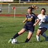 Trenton's Makenna Mascaro (20) makes a move around  Taylor Truman defender Cheyenne Cope (15). Mascaro scored one of the eight goals as the Trojans downed host Truman 8-0 in a mercy rule-shortened game on Monday. (MI Prep Zone photo gallery by RYAN DICKEY)