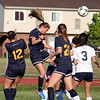 Brooke Honeycutt of Trenton heads the ball toward the Taylor Truman goal while surrounded by five other players. The Trojans scored four goals in each half to down host Truman 8-0 in a mercy rule-shortened game on Monday. (MI Prep Zone photo gallery by RYAN DICKEY)