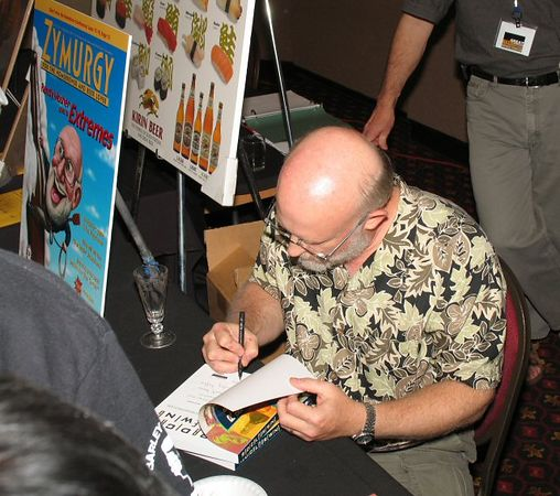 Randy Moser signs another book.