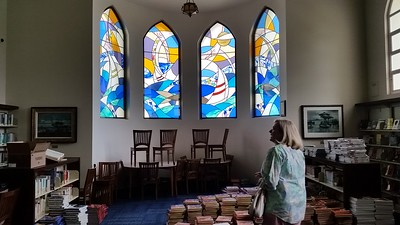 The stained glass windows in the school library were funded by several NHHS classes. They are a highlight of this art-filled room.