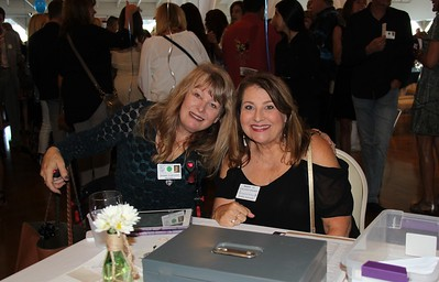 Check-in volunteers Debbie Subcasky Maxwell and sister Mary Subcasky