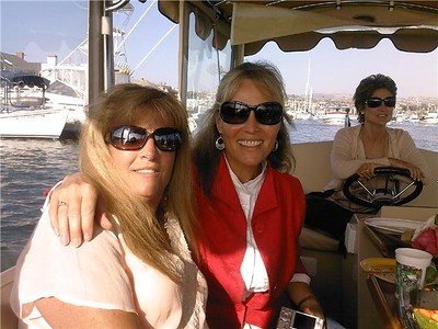 Brenda Bailey, Kitty Stamper, and Leslie Koehn on a bay cruise with the Balboa babes, but what's with all the bug-eyed sun glasses?