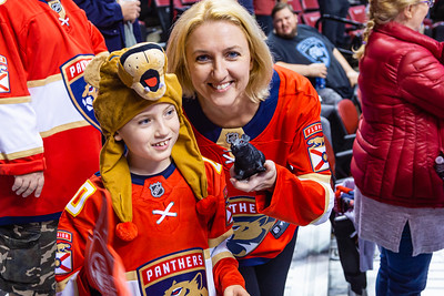 Two Panther fans and their plastic rat watch the pregame warmup skate at the BB&T Center on Thursday, January 9, 2020, where the Florida Panther hosted the Vancouver Canucks. The Panthers would go on to beat the Canucks 5-2.  [JOSEPH FORZANO/palmbeachpost.com]